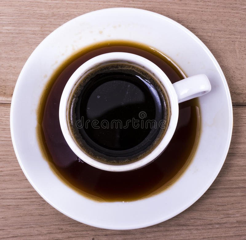 Dirty cup. Image of white dirty cup of coffee on wood backgraund macro royalty free stock photo