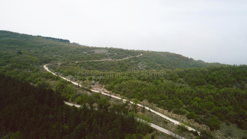 Dirty Curve Road In The Mountains. Aerial View Of Dirty Curve Road In The Mountains royalty free stock photo