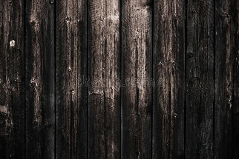 Dirty dark shabby wooden table. Black wooden fence texture background. Wood pattern, surface. Old wall wooden vintage floor. Close royalty free stock image