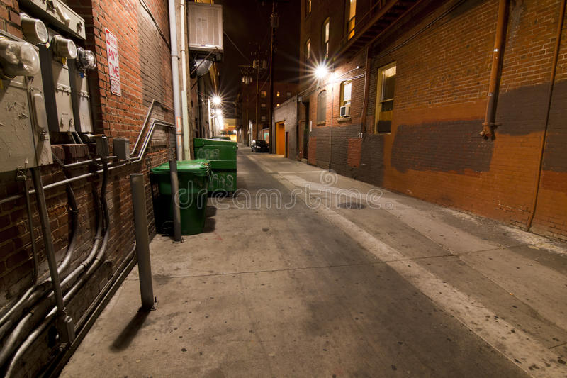 Dirty Dark Urban Alley. Downtown Reno Dark Urban Alley stock photos
