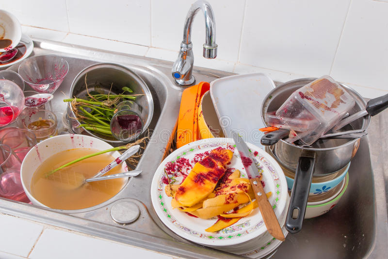 Dirty dishes. Huge heap of dirty dishes royalty free stock photography