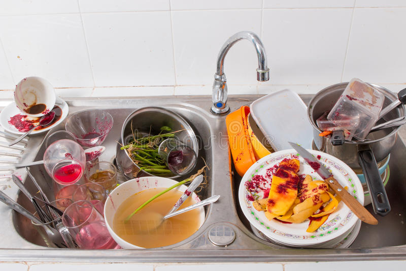 Dirty dishes. Huge heap of dirty dishes stock photography