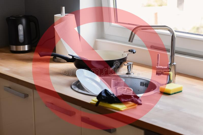 Dirty dishes lying in the sink. Conceptual photo about gender inequality and oppression of women stock images