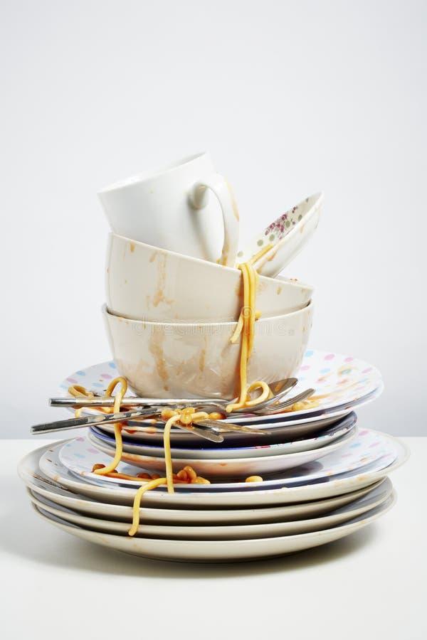 Free Dirty Dishes Pile Needing Washing Up On White Background Stock Images - 39591074