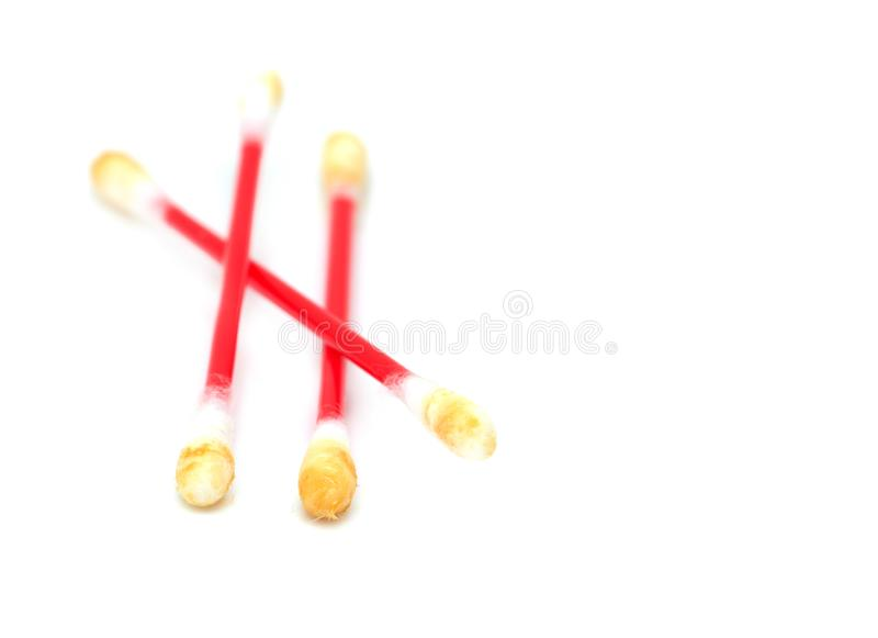 Dirty ear sticks on a white background stock images