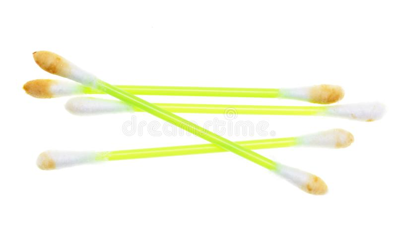 Dirty ear sticks on a white background royalty free stock image