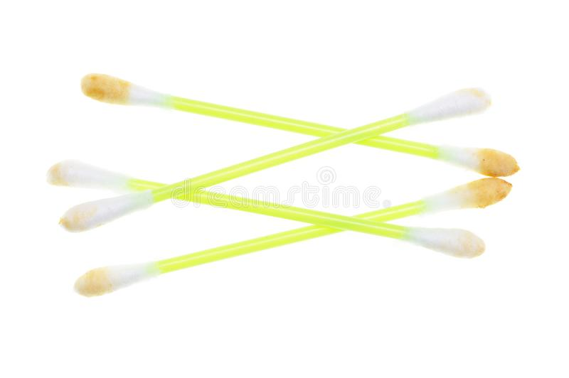 Dirty ear sticks on a white background stock photography