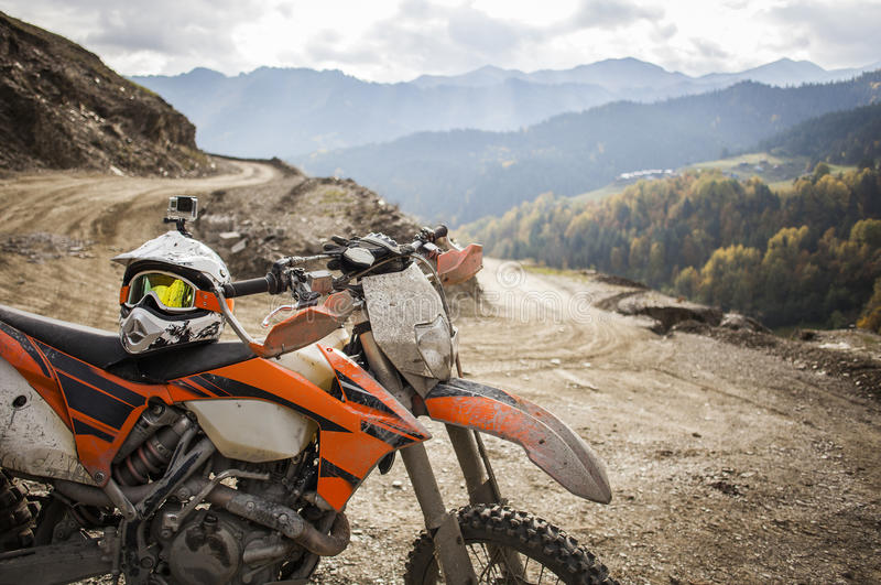Dirty enduro motorcycle motocross helmet on road stock image