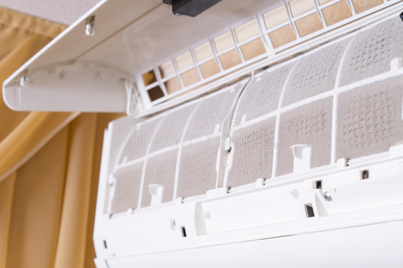 Dirty filter of air conditioner. Cleaning and washing maintenance. Removing dirty air-conditioner filter for washing. stock image