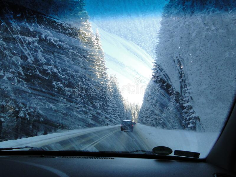 Dirty front car wind screen - dashboard passanger perspective - driving thru forest in polish mountains stock photo