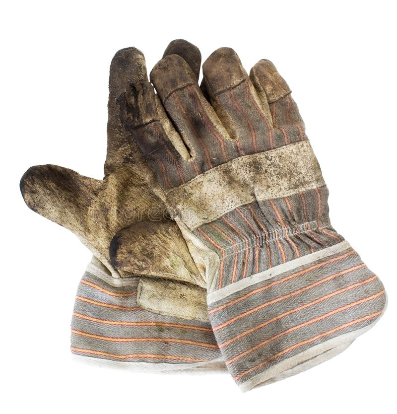 Dirty gloves royalty free stock photography