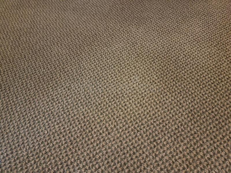 Dirty grey and brown carpet or rug or background. Dirty grey and brown carpet or rug or textile or background royalty free stock photo