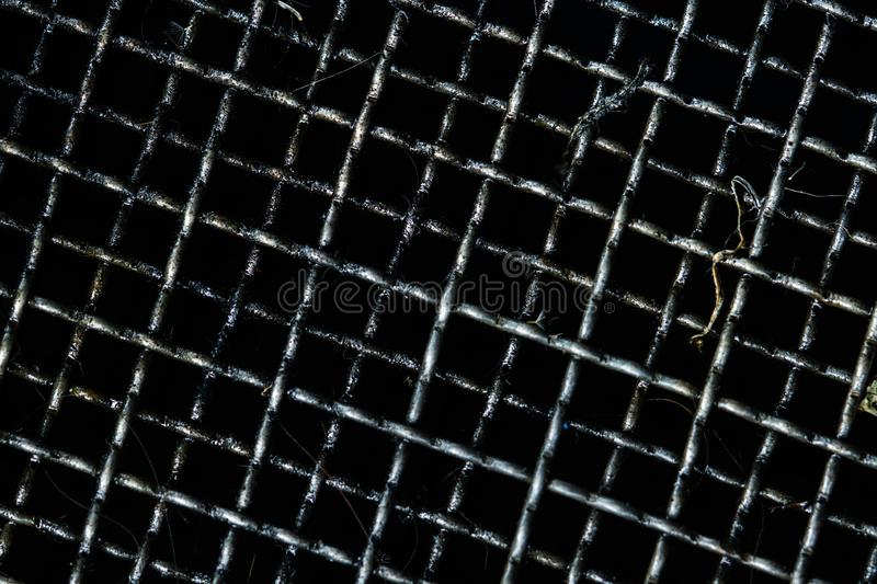 Dirty grille for filter and collect used motor oil in car or motorcycle. Black oil or automotive fluids stains on grille. Recycling used motor oil reused as stock images