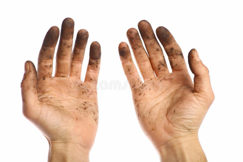 Dirty hands. Color shot of two dirty hands, isolated on white stock images