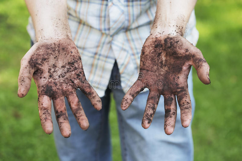 Dirty hands stock photo
