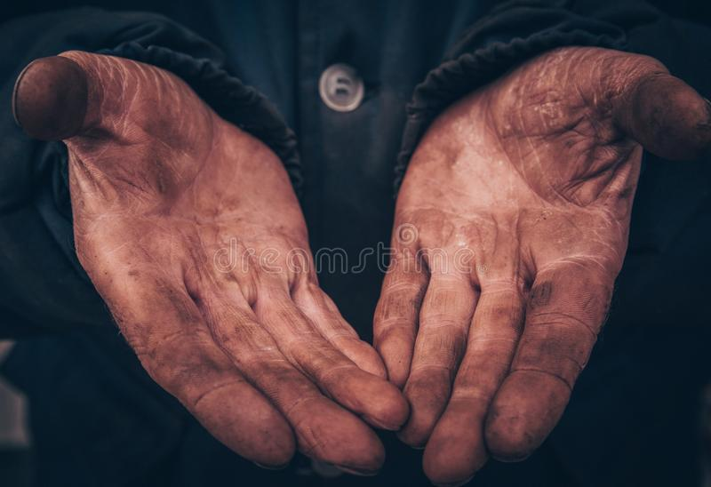 Dirty hands of a man, a working man, a man drained his hands while working, a poor man royalty free stock photos