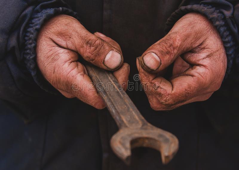 Dirty hands of a man, a working man, a man drained his hands while working, a poor man stock images
