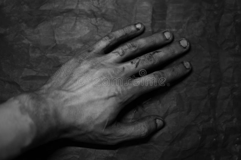 Dirty hands of mechanic at car station stock photo