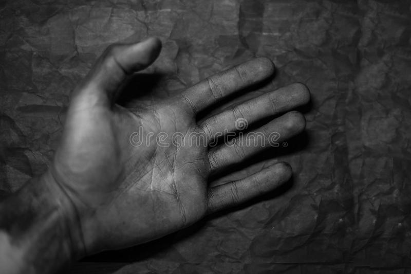 Dirty hands of mechanic at car station royalty free stock photography