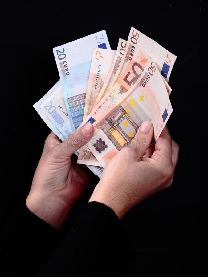 Dirty hands and money. Dirty hands grabbing Euro banknotes royalty free stock photos