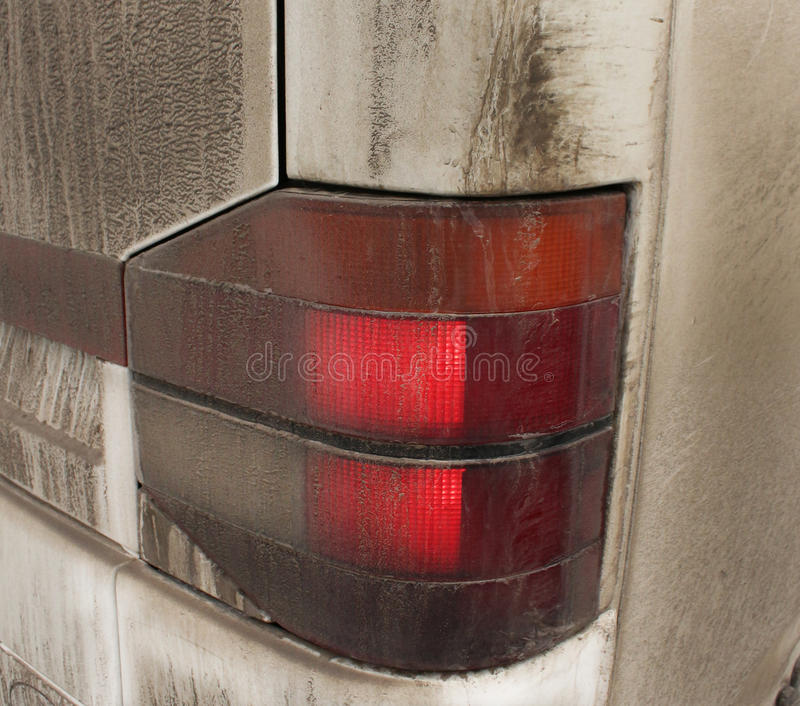 Dirty headlight of car. Element of bus,a back headlight is illumination royalty free stock photography