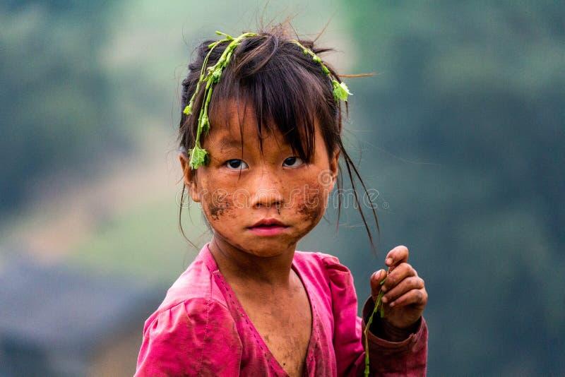 Dirty Hmong ethnic minority child portrait Ha Giang Vietnam stock photo