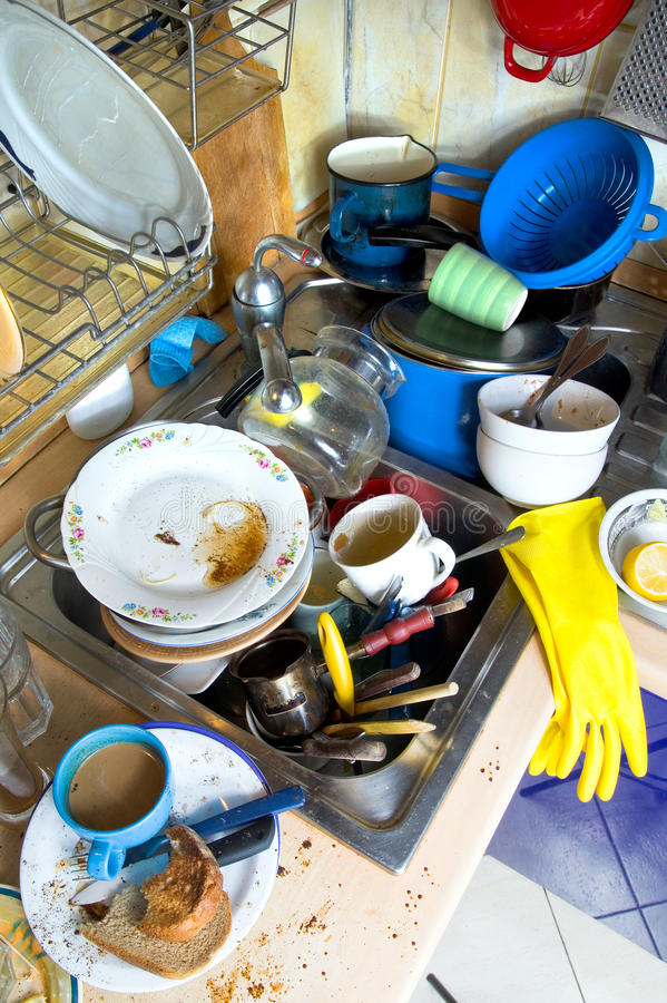 Dirty kitchen unwashed dishes royalty free stock images