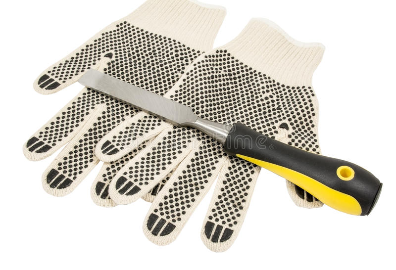 Dirty leather gloves and chisel stock photos