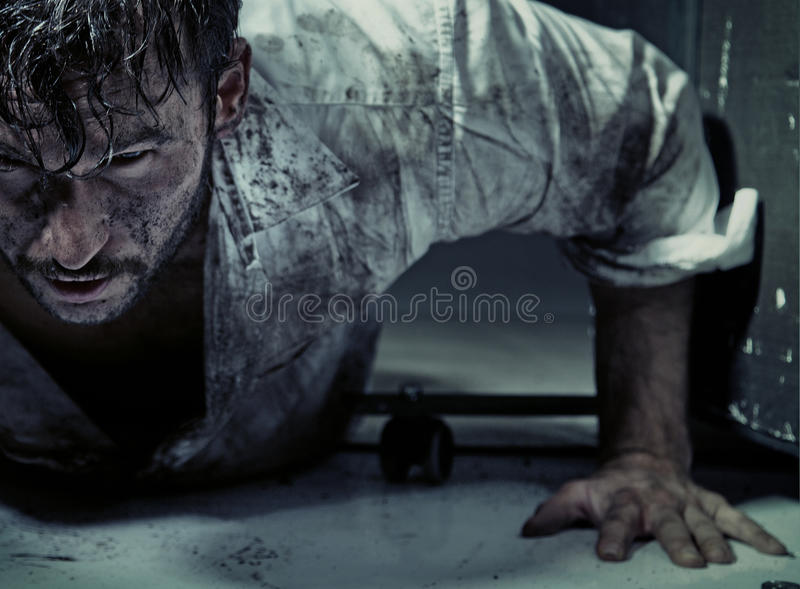 Dirty man trying to get up royalty free stock photos