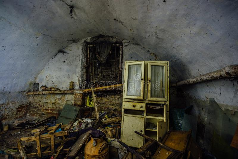 Dirty messy abandoned vaulted underground cellar. Homeless or drug addicts refuge stock photos
