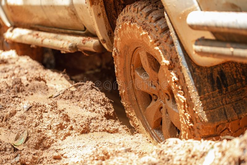 Dirty offroad car, SUV covered with mud on countryside road, Off-road tires, offroad travel and driving concept.  stock photos
