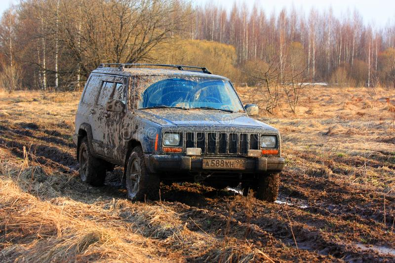 Dirty offroad car. A trip to the nature, off-road. Russia, the Ryazan Region. April 7, 2017 stock photography
