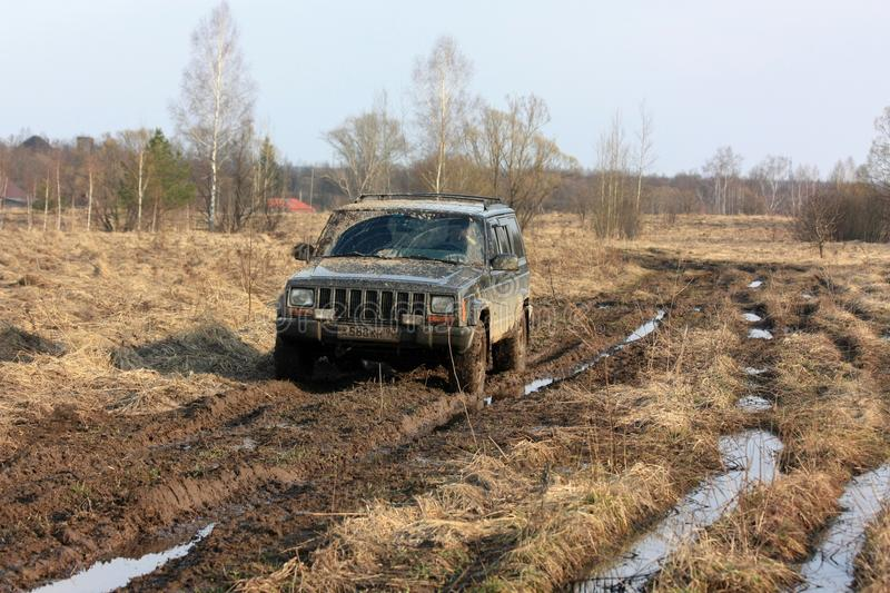 Dirty offroad car. A trip to the nature, off-road. Russia, the Ryazan Region. April 7, 2017 royalty free stock photography