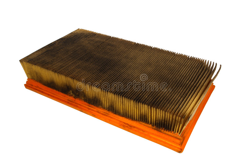 Dirty and Oily Used Automobile Air Filter Isolated stock photography