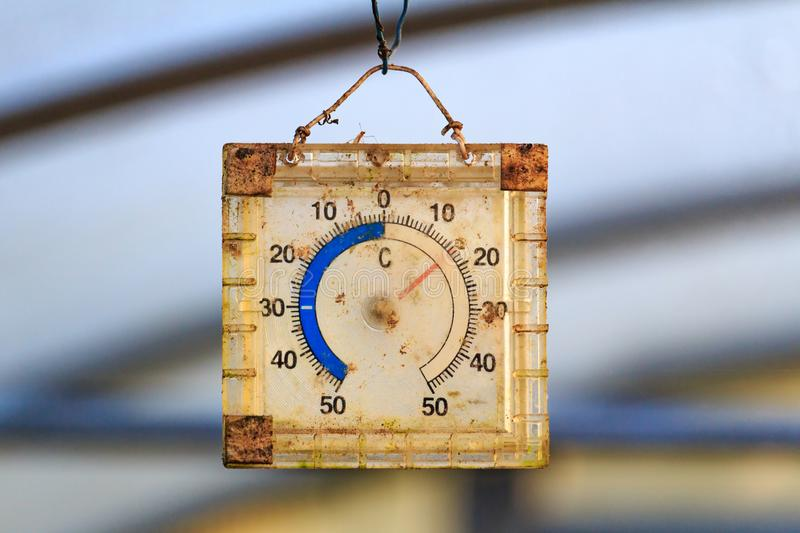 Dirty old analog thermometer in the greenhouse closeup stock photo