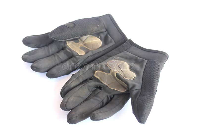 Dirty old black gloves stock images