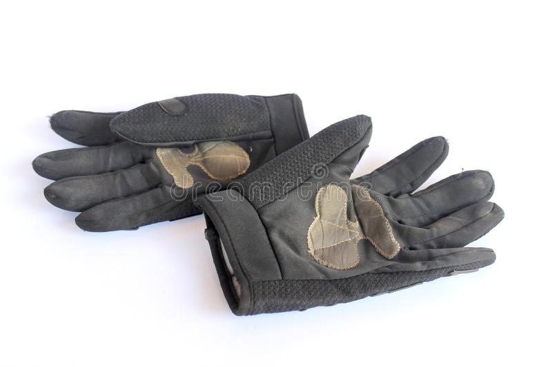 Dirty old black gloves royalty free stock image