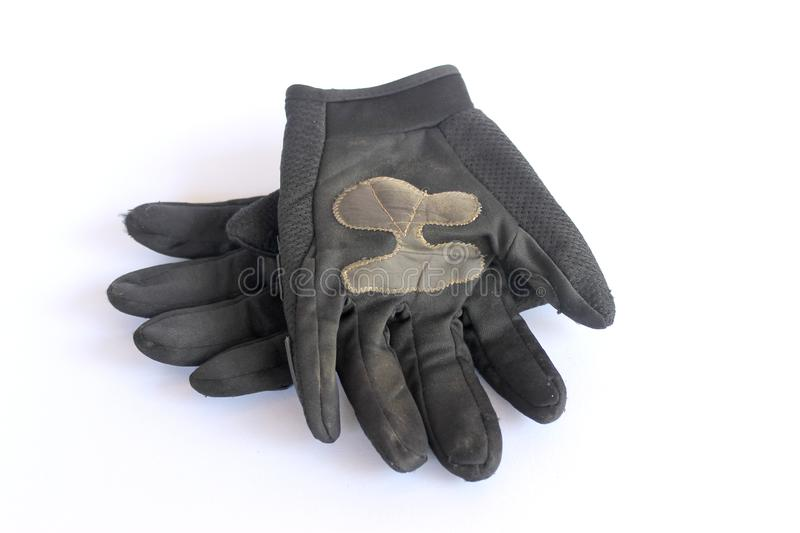 Dirty old black gloves stock photos