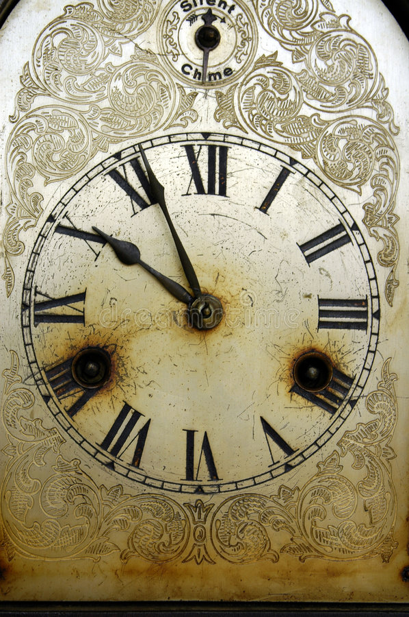 Dirty Old Clock stock photo