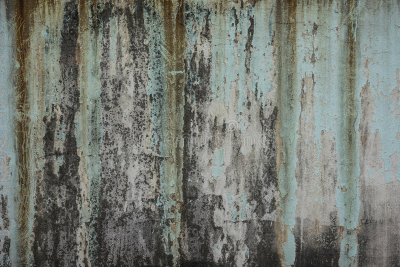 Dirty old green weathered painted wall as background stock photography