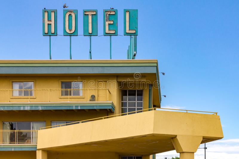 Dirty old hotel sign on the top of a highway motel in an America stock photo