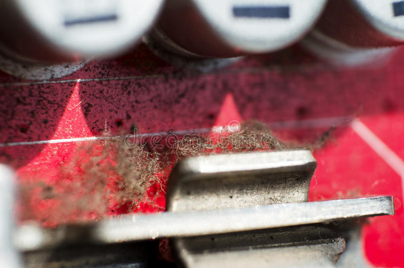 Dirty old motherboard. Closeup of a red printed circuit board with dust stock image