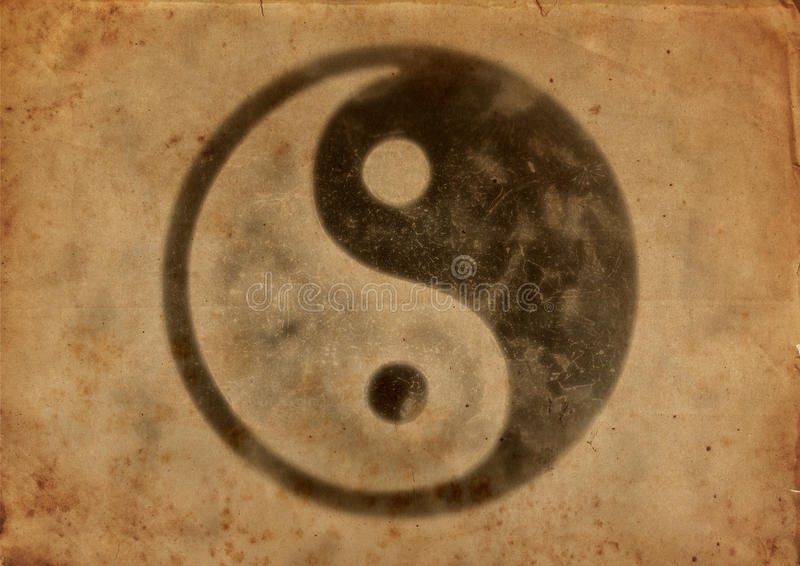 Yin And Yang Dirty old paper with yin yang logo. Abstract of the symbol for yin and yang with calligraphy. Dirty old paper with yin yang logo vintage look royalty free stock image