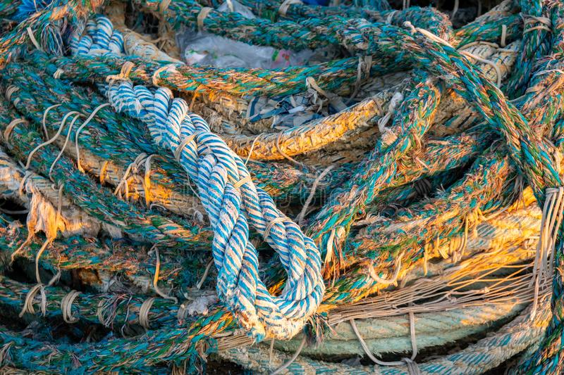 Dirty old rope and nets for fishing on the dock royalty free stock images