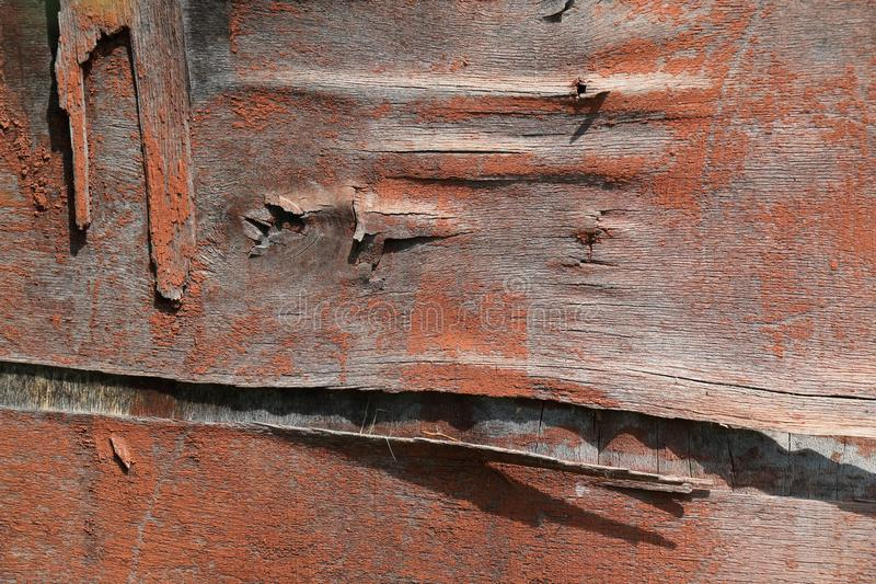 Dirty old and weathered red wooden surface. Plywood in bad condition stock image