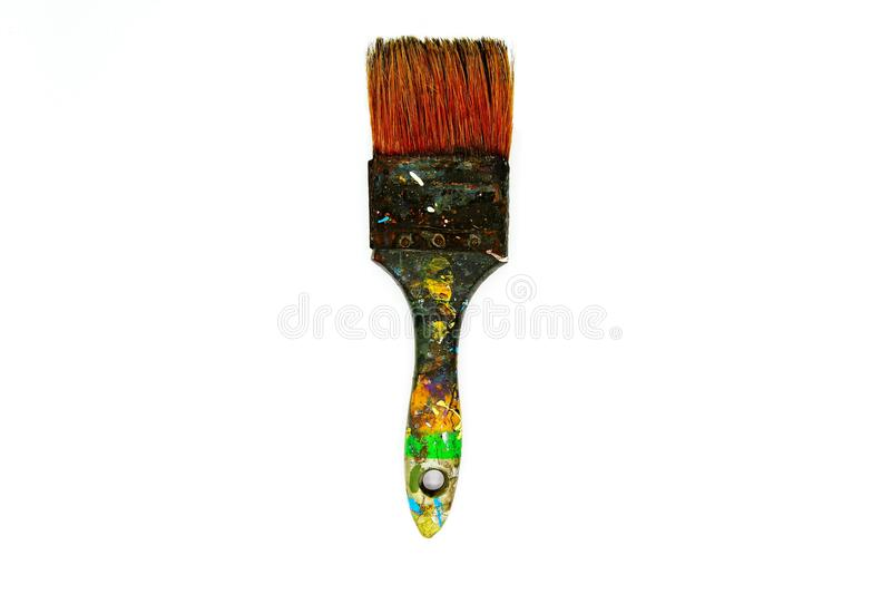 Dirty paint brush be stained with color on isolated white background royalty free stock photography