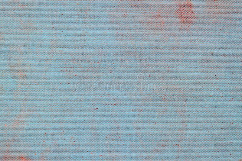 Dirty canvas, sackcloth or burlap with visible texture. Close up of jute, texture pattern for blue red background stock image