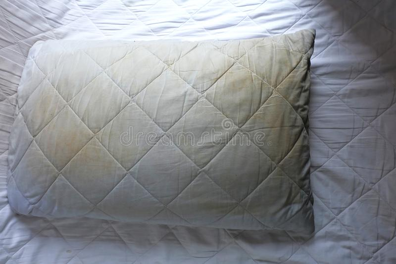 Dirty pillows on white beds. Are a source of germs and dust mites and mattresses royalty free stock images