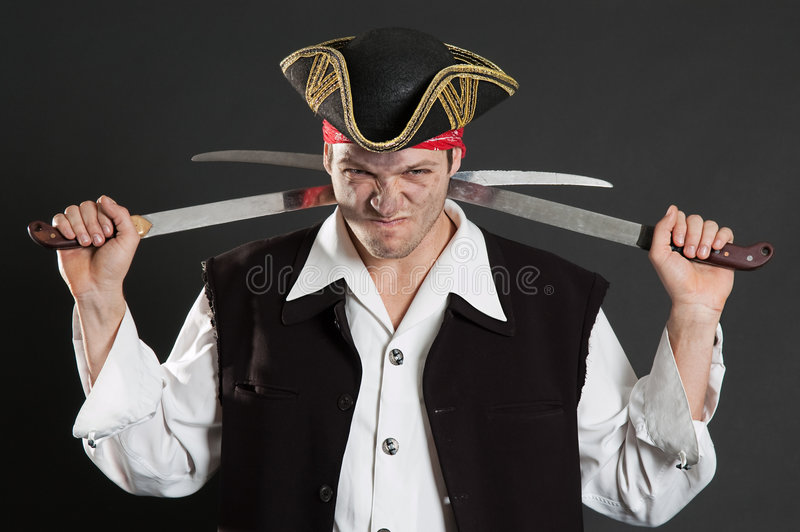 Dirty pirate with two sabres royalty free stock images