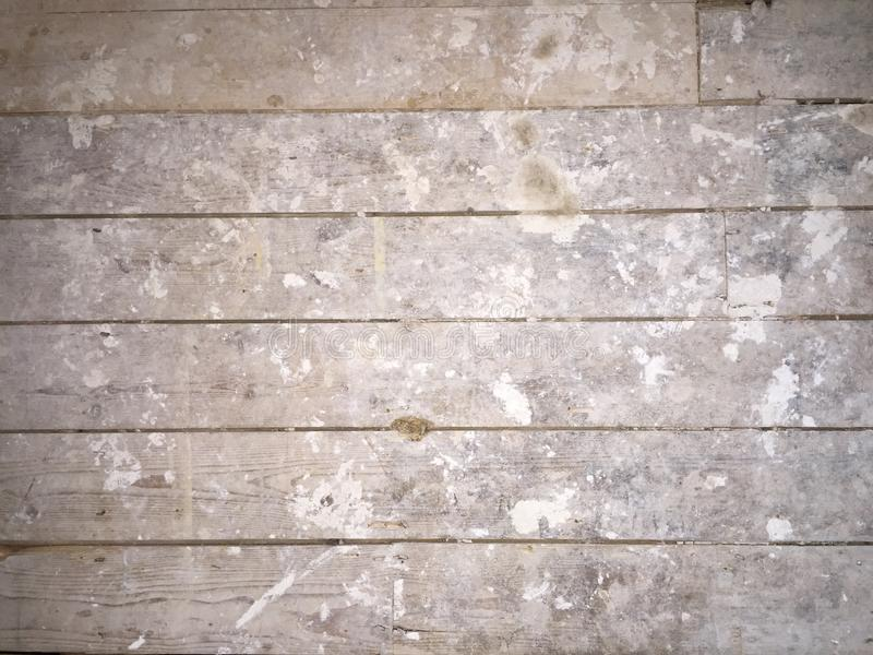 Dirty plaster covered floorboards stock image